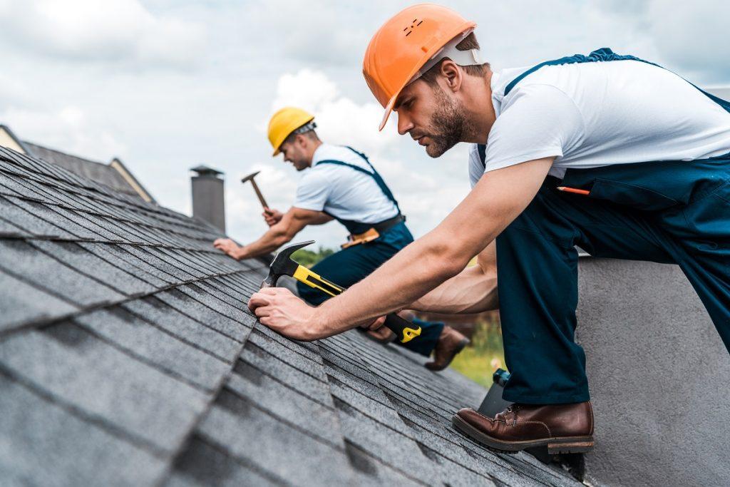 long island roofer installing shingles