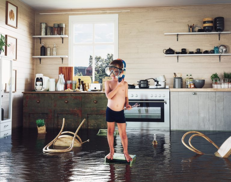 Child Playing in a Flooded Kitchen