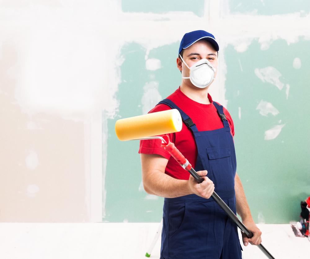 Painter Holding a Roller Brush